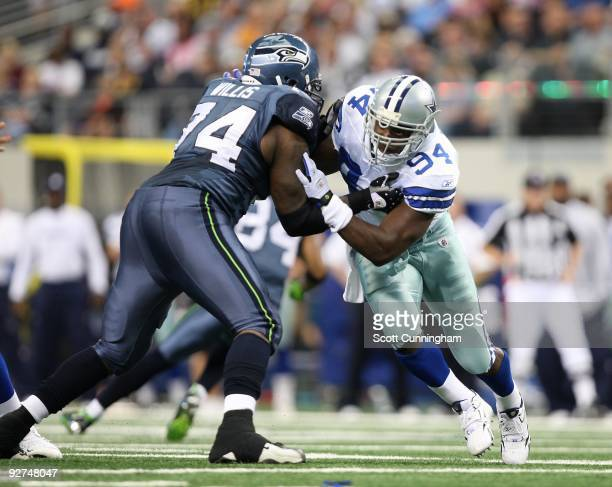 DeMarcus Ware of the Dallas Cowboys rushes the passer against Ray Willis of the Seattle Seahawks at Cowboys Stadium on November 1 2009 in Arlington...