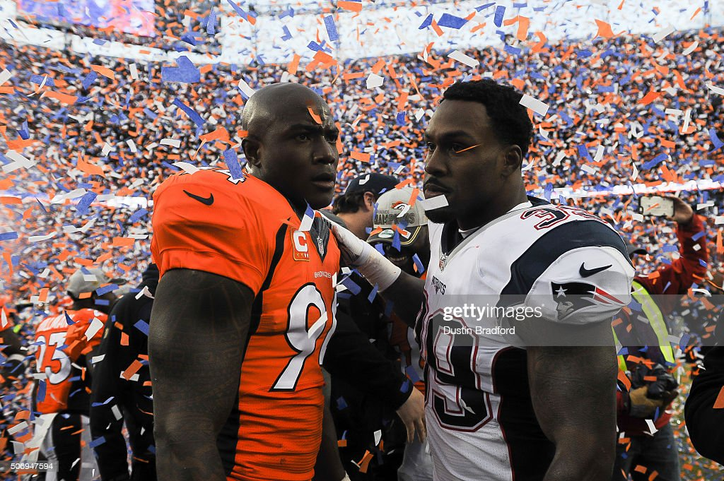 DeMarcus Ware of the Denver Broncos and Steven Jackson of the New England Patriots meet on the field after the AFC Championship game at Sports...