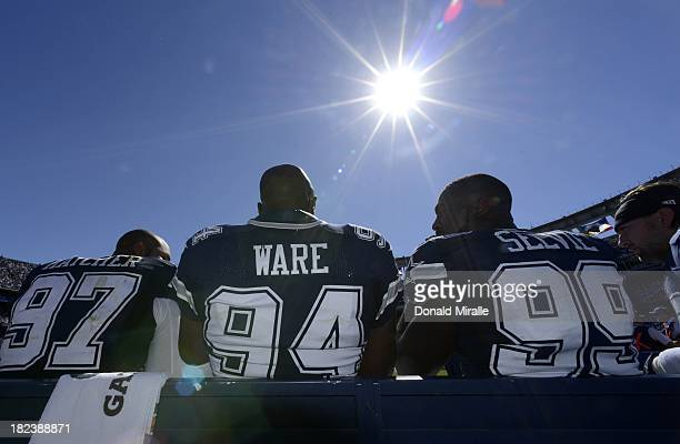 DeMarcus Ware talks with teammates Jason Hatcher and George Selvie of the Dallas Cowboys during the game against the San Diego Chargers on September...