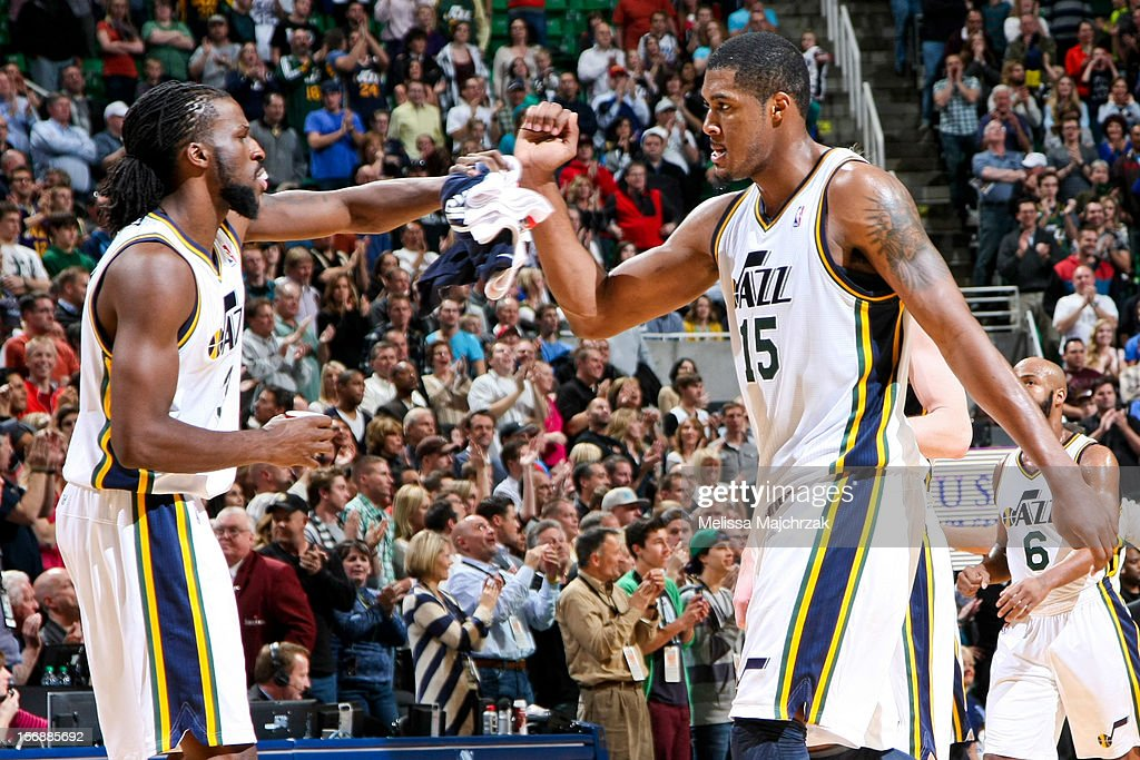 <a gi-track='captionPersonalityLinkClicked' href=/galleries/search?phrase=DeMarre+Carroll&family=editorial&specificpeople=784686 ng-click='$event.stopPropagation()'>DeMarre Carroll</a> #3 and <a gi-track='captionPersonalityLinkClicked' href=/galleries/search?phrase=Derrick+Favors&family=editorial&specificpeople=5792014 ng-click='$event.stopPropagation()'>Derrick Favors</a> #15 of the Utah Jazz celebrate while playing against the Sacramento Kings at Energy Solutions Arena on November 23, 2012 in Salt Lake City, Utah.