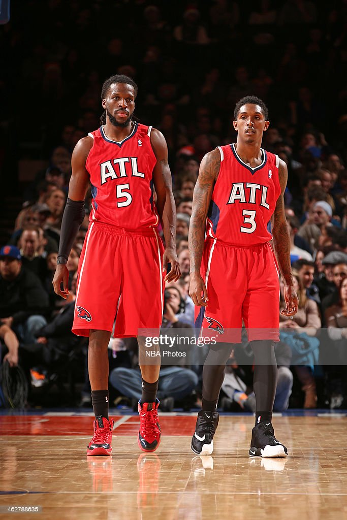 <a gi-track='captionPersonalityLinkClicked' href=/galleries/search?phrase=DeMarre+Carroll&family=editorial&specificpeople=784686 ng-click='$event.stopPropagation()'>DeMarre Carroll</a> #5 and <a gi-track='captionPersonalityLinkClicked' href=/galleries/search?phrase=Louis+Williams&family=editorial&specificpeople=670315 ng-click='$event.stopPropagation()'>Louis Williams</a> #3 of the Atlanta Hawks walk off the court against the New York Knicks during a game at Madison Square Garden in New York City.