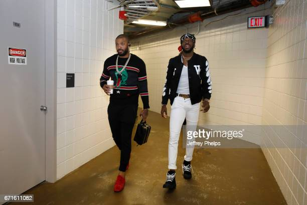 DeMarre Carroll and PJ Tucker of the Toronto Raptors are seen before the game against the Milwaukee Bucks during Game Four of the Eastern Conference...