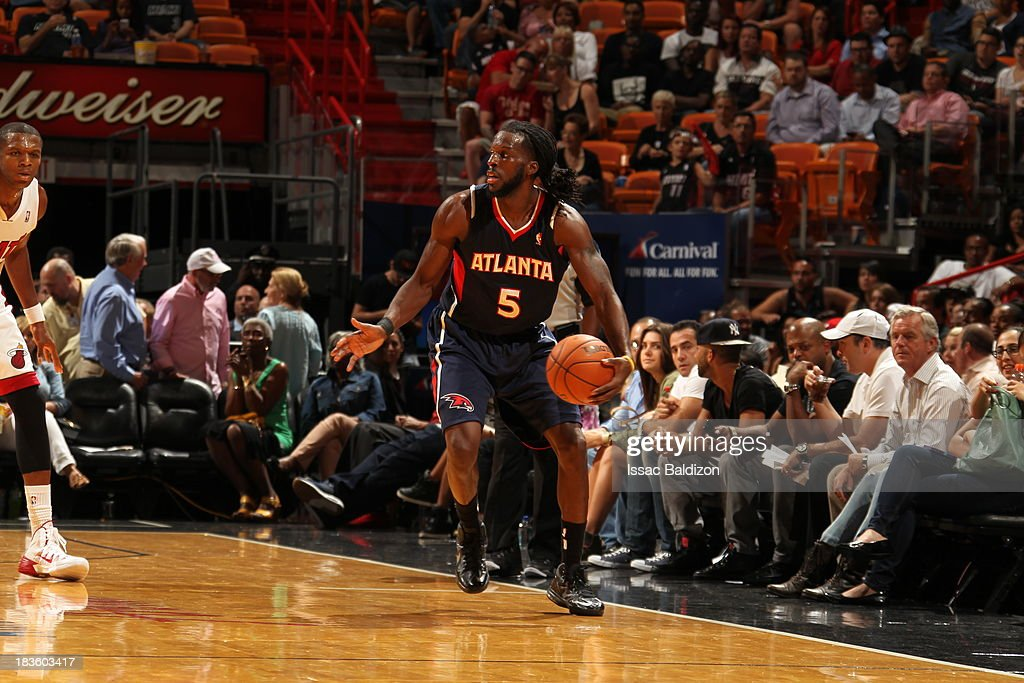 <a gi-track='captionPersonalityLinkClicked' href=/galleries/search?phrase=DeMarre+Carroll&family=editorial&specificpeople=784686 ng-click='$event.stopPropagation()'>DeMarre Carroll</a> #5 of the Atlanta Hawks dribbles the ball against the Miami Heat during a game on October 7, 2013 at American Airlines Arena in Miami, Florida.