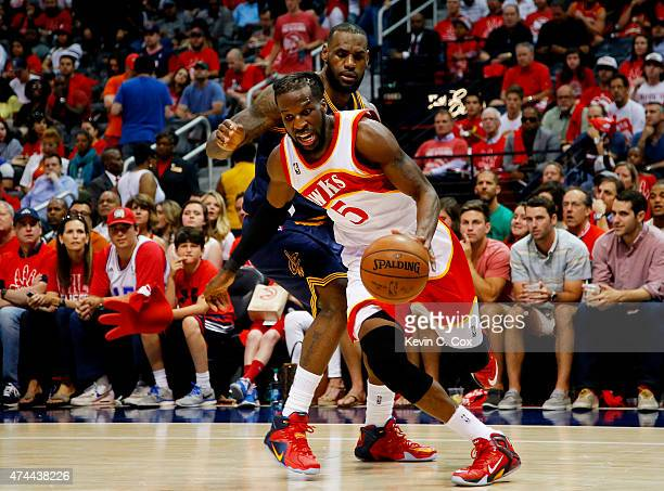 DeMarre Carroll of the Atlanta Hawks drives against LeBron James of the Cleveland Cavaliers in the third quarter during Game Two of the Eastern...