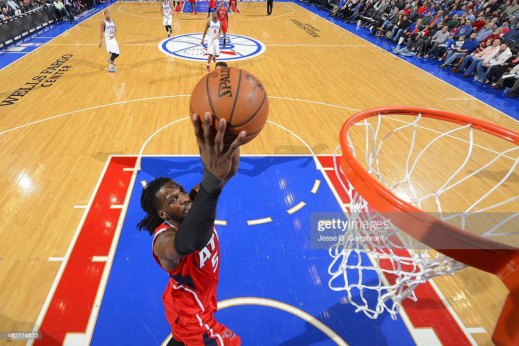 <a gi-track='captionPersonalityLinkClicked' href=/galleries/search?phrase=DeMarre+Carroll&family=editorial&specificpeople=784686 ng-click='$event.stopPropagation()'>DeMarre Carroll</a> #5 of the Atlanta Hawks dunks against the Philadelphia 76ers at the Wells Fargo Center on January 31, 2014 in Philadelphia, Pennsylvania.
