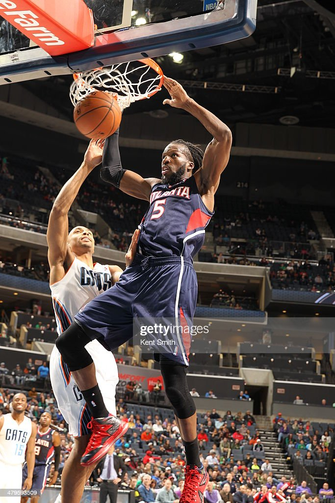 DeMarre Carroll #5 of the Atlanta Hawks dunks the ball against the Charlotte Bobcats during the game at the Time Warner Cable Arena on March 17, 2014 in Charlotte, North Carolina.