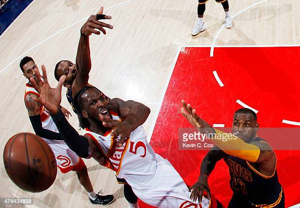 DeMarre Carroll of the Atlanta Hawks goes up against LeBron James of the Cleveland Cavaliers in the second quarter during Game Two of the Eastern...