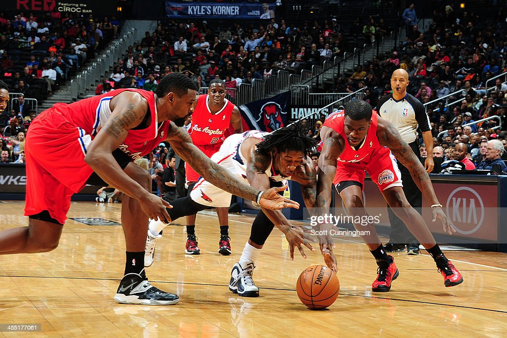 <a gi-track='captionPersonalityLinkClicked' href=/galleries/search?phrase=DeMarre+Carroll&family=editorial&specificpeople=784686 ng-click='$event.stopPropagation()'>DeMarre Carroll</a> #5 of the Atlanta Hawks grabs the loose ball against <a gi-track='captionPersonalityLinkClicked' href=/galleries/search?phrase=DeAndre+Jordan&family=editorial&specificpeople=4665718 ng-click='$event.stopPropagation()'>DeAndre Jordan</a> #6 of the Los Angeles Clippers on December 4, 2013 at Philips Arena in Atlanta, Georgia.
