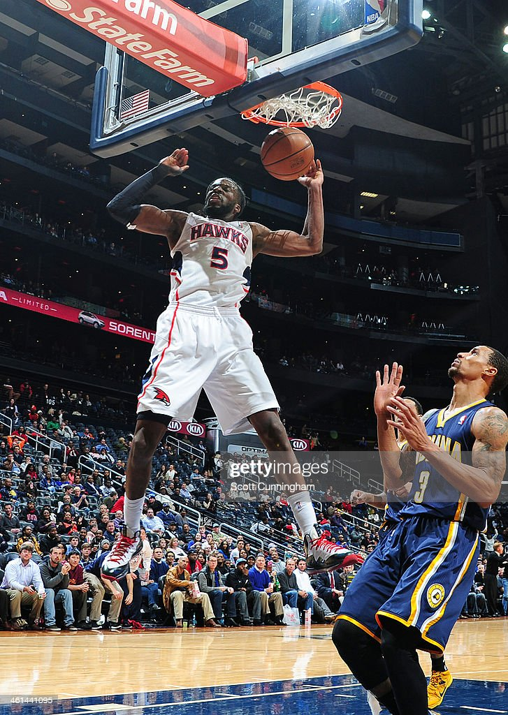 <a gi-track='captionPersonalityLinkClicked' href=/galleries/search?phrase=DeMarre+Carroll&family=editorial&specificpeople=784686 ng-click='$event.stopPropagation()'>DeMarre Carroll</a> #5 of the Atlanta Hawks hanging in the air after a shot during a game against the Indiana Pacers of the Atlanta Hawks against of the Indiana Pacers on January 8, 2014 at Philips Arena in Atlanta, Georgia.