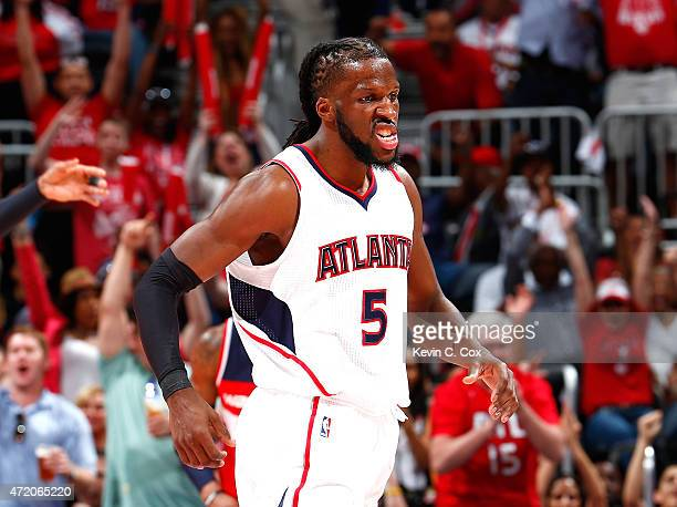 DeMarre Carroll of the Atlanta Hawks reacts after hitting a threepoint basket against the Washington Wizards during Game One of the Eastern...