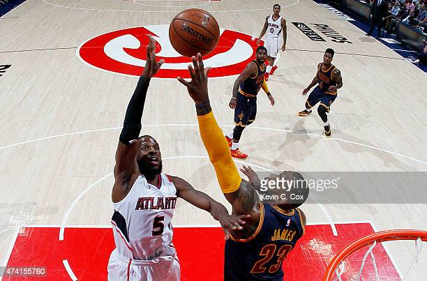 DeMarre Carroll of the Atlanta Hawks shoots against LeBron James of the Cleveland Cavaliers in the first half during Game One of the Eastern...