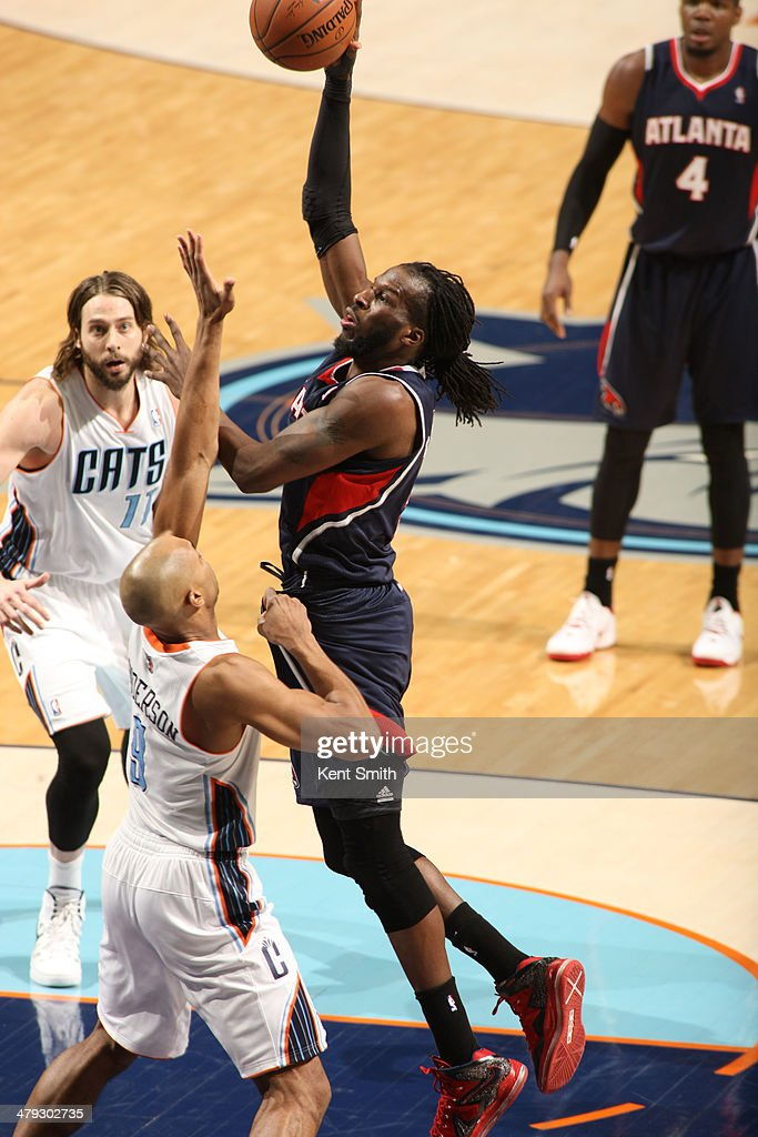 DeMarre Carroll #5 of the Atlanta Hawks shoots against the Charlotte Bobcats during the game at the Time Warner Cable Arena on March 17, 2014 in Charlotte, North Carolina.