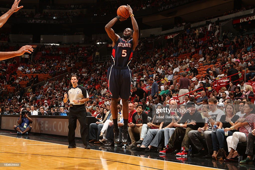 <a gi-track='captionPersonalityLinkClicked' href=/galleries/search?phrase=DeMarre+Carroll&family=editorial&specificpeople=784686 ng-click='$event.stopPropagation()'>DeMarre Carroll</a> #5 of the Atlanta Hawks shoots the ball against the Miami Heat during a game on October 7, 2013 at American Airlines Arena in Miami, Florida.