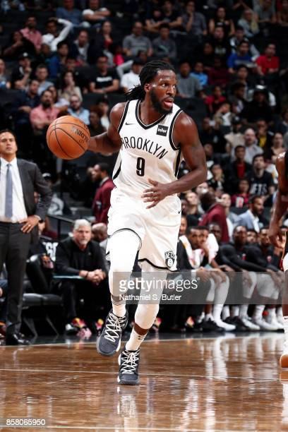 DeMarre Carroll of the Brooklyn Nets brings the ball up court during the game against the Miami Heat during a preseason game on October 5 2017 at...