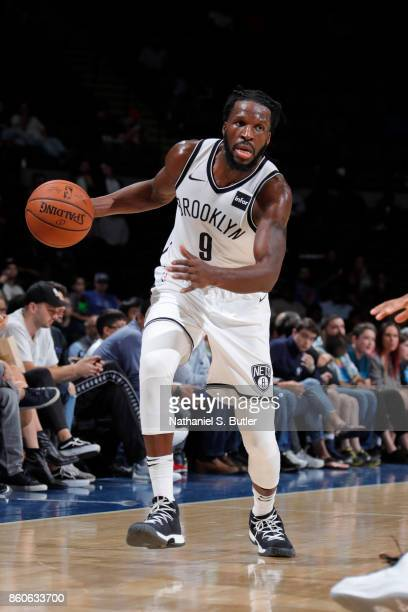 DeMarre Carroll of the Brooklyn Nets handles the ball against the Philadelphia 76ers on October 11 2017 at Nassau Veterans Memorial Coliseum in...
