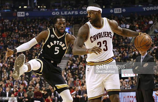 DeMarre Carroll of the Toronto Raptors defends against LeBron James of the Cleveland Cavaliers on November 25 2015 at Air Canada Centre in Toronto...