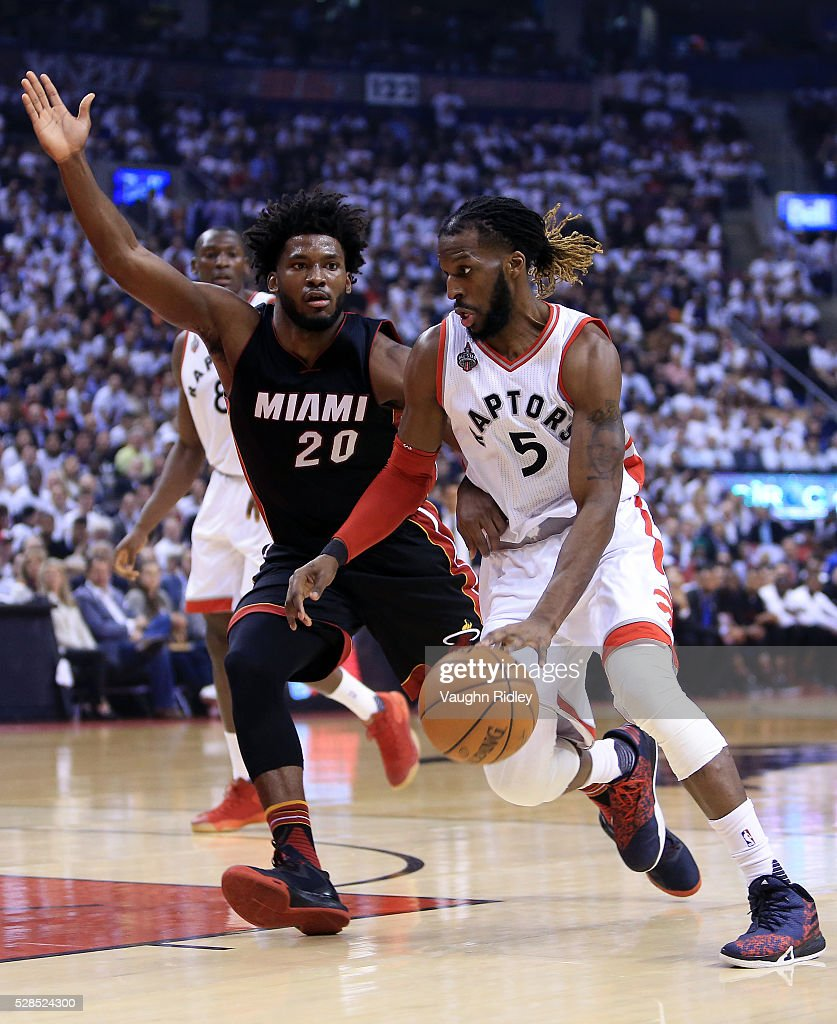 <a gi-track='captionPersonalityLinkClicked' href=/galleries/search?phrase=DeMarre+Carroll&family=editorial&specificpeople=784686 ng-click='$event.stopPropagation()'>DeMarre Carroll</a> #5 of the Toronto Raptors dribbles the ball as Justice Winslow #20 of the Miami Heat defends in the first half of Game Two of the Eastern Conference Semifinals during the 2016 NBA Playoffs at the Air Canada Centre on May 5, 2016 in Toronto, Ontario, Canada.