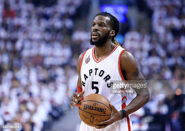 DeMarre Carroll of the Toronto Raptors dribbles the ball in the first half of Game Seven of the Eastern Conference Quarterfinals against the Miami...