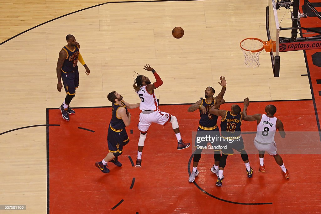DeMarre Carroll #5 of the Toronto Raptors drives to the basket and shoots the ball in Game Six of the NBA Eastern Conference Finals against the Cleveland Cavaliers at Air Canada Centre on May 27, 2016 in Toronto, Ontario, Canada.