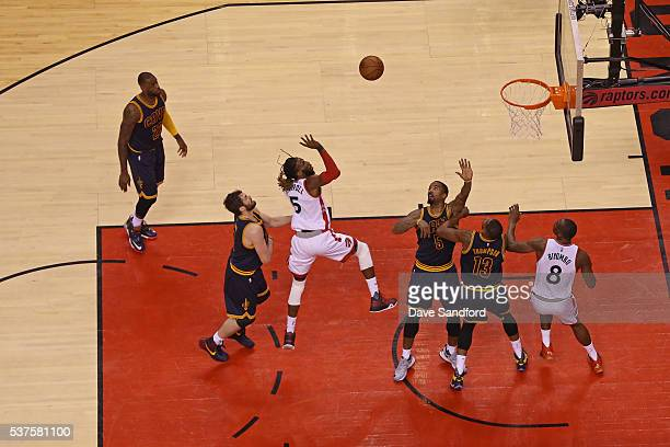DeMarre Carroll of the Toronto Raptors drives to the basket and shoots the ball in Game Six of the NBA Eastern Conference Finals against the...