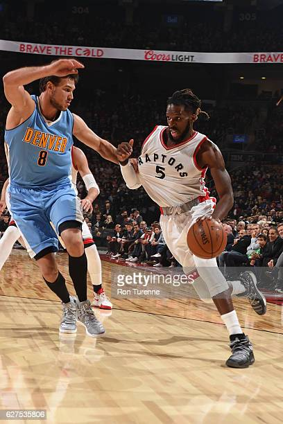 DeMarre Carroll of the Toronto Raptors drives to the basket during the game against Danilo Gallinari of the Denver Nuggets on October 31 2016 at the...