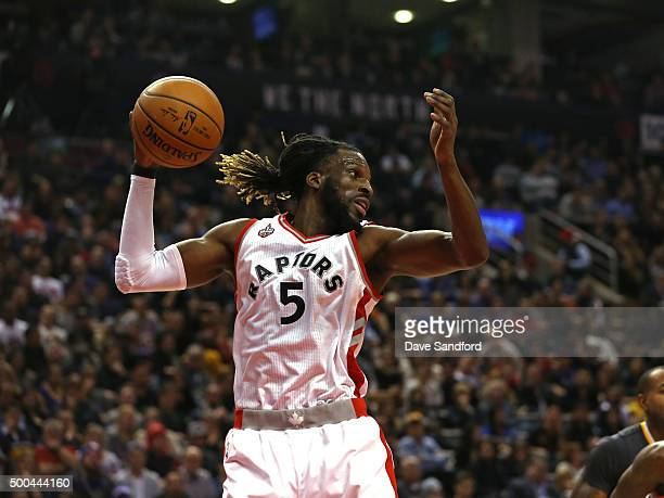 DeMarre Carroll of the Toronto Raptors grabs the rebound against the Golden State Warriors on December 5 2015 at Air Canada Centre in Toronto Ontario...