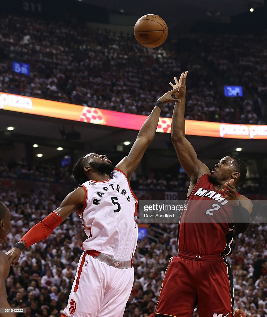 <a gi-track='captionPersonalityLinkClicked' href=/galleries/search?phrase=DeMarre+Carroll&family=editorial&specificpeople=784686 ng-click='$event.stopPropagation()'>DeMarre Carroll</a> #5 of the Toronto Raptors guards against <a gi-track='captionPersonalityLinkClicked' href=/galleries/search?phrase=Joe+Johnson+-+Basketball+Player&family=editorial&specificpeople=201652 ng-click='$event.stopPropagation()'>Joe Johnson</a> #2 of the Miami Heat during Game Seven of the NBA Eastern Conference Semi Finals at Air Canada Centre on May 15, 2016 in Toronto, Ontario, Canada.