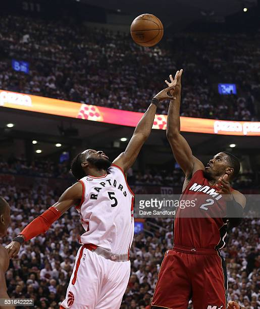 DeMarre Carroll of the Toronto Raptors guards against Joe Johnson of the Miami Heat during Game Seven of the NBA Eastern Conference Semi Finals at...