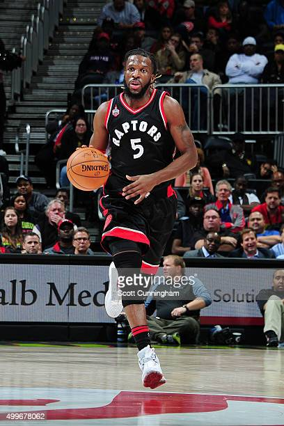 DeMarre Carroll of the Toronto Raptors handles the ball during the game against the Atlanta Hawks on December 2 2015 at Philips Arena in Atlanta...