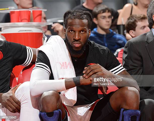 DeMarre Carroll of the Toronto Raptors looks on from the bench against the Minnesota Timberwolves during a preseason game on October 12 2015 at the...
