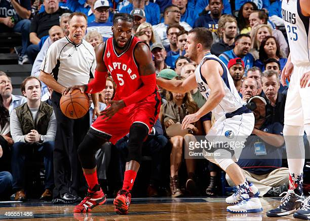 DeMarre Carroll of the Toronto Raptors posts up against Jose Juan Barea of the Dallas Mavericks on November 3 2015 at the American Airlines Center in...