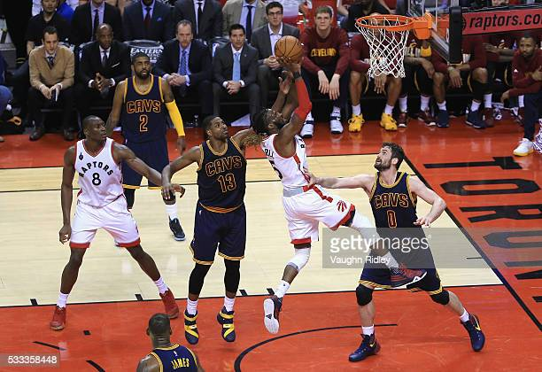 DeMarre Carroll of the Toronto Raptors shoots the ball against Tristan Thompson of the Cleveland Cavaliers and Kevin Love during the second half in...