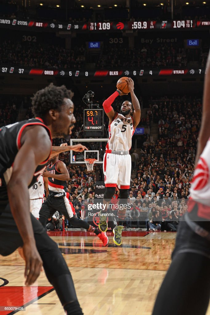 DeMarre Carroll #5 of the Toronto Raptors shoots the ball against the Portland Trail Blazers on February 26, 2017 at the Air Canada Centre in Toronto, Ontario, Canada.