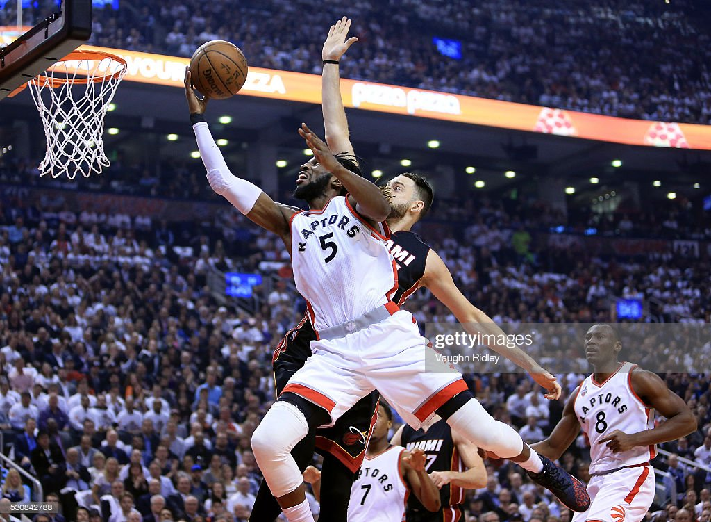 <a gi-track='captionPersonalityLinkClicked' href=/galleries/search?phrase=DeMarre+Carroll&family=editorial&specificpeople=784686 ng-click='$event.stopPropagation()'>DeMarre Carroll</a> #5 of the Toronto Raptors shoots the ball and is fouled by <a gi-track='captionPersonalityLinkClicked' href=/galleries/search?phrase=Josh+McRoberts&family=editorial&specificpeople=732530 ng-click='$event.stopPropagation()'>Josh McRoberts</a> #4 of the Miami Heat in the first half of Game Five of the Eastern Conference Semifinals during the 2016 NBA Playoffs at the Air Canada Centre on May 11, 2016 in Toronto, Ontario, Canada.