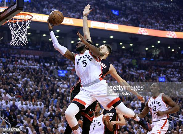 DeMarre Carroll of the Toronto Raptors shoots the ball and is fouled by Josh McRoberts of the Miami Heat in the first half of Game Five of the...