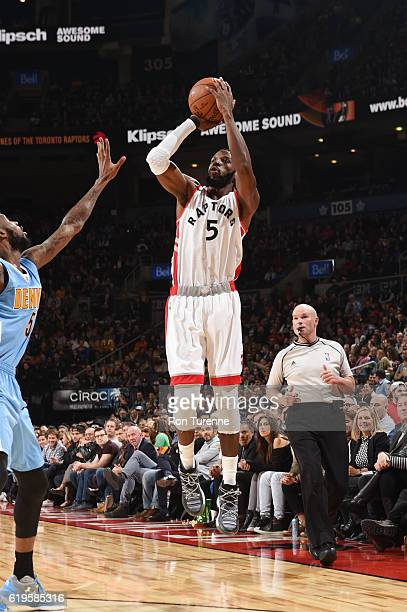 DeMarre Carroll of the Toronto Raptors shoots the ball during a game against the Denver Nuggets on October 31 2016 at the Air Canada Centre in...