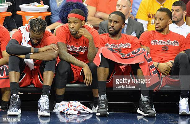 DeMarre Carroll of the Toronto Raptors Terrence Ross Patrick Patterson and Norman Powell react on the bench during the second half against the...