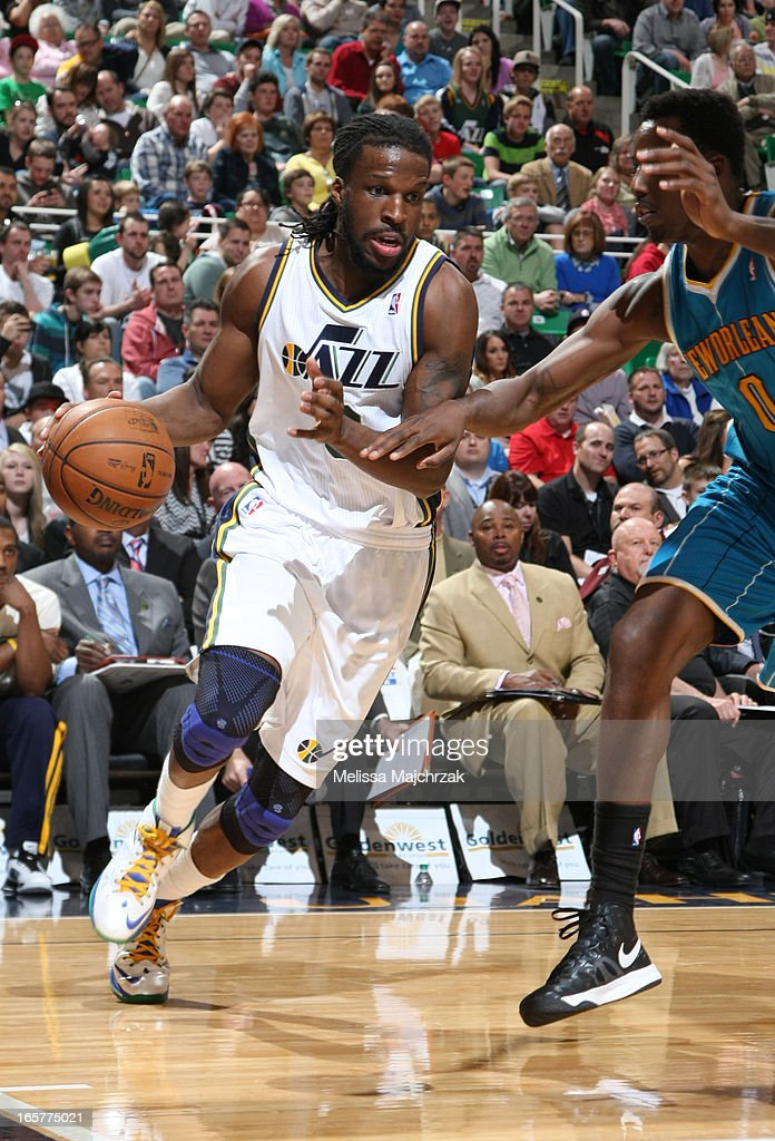 Demarre Carroll #3 of the Utah Jazz drives against Al-Farouq Aminu #0 of the New Orleans Hornets at Energy Solutions Arena on April 5, 2013 in Salt Lake City, Utah.