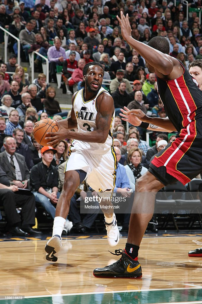 <a gi-track='captionPersonalityLinkClicked' href=/galleries/search?phrase=DeMarre+Carroll&family=editorial&specificpeople=784686 ng-click='$event.stopPropagation()'>DeMarre Carroll</a> #3 of the Utah Jazz drives against <a gi-track='captionPersonalityLinkClicked' href=/galleries/search?phrase=Chris+Bosh&family=editorial&specificpeople=201574 ng-click='$event.stopPropagation()'>Chris Bosh</a> #1 of the Miami Heat at Energy Solutions Arena on January 14, 2013 in Salt Lake City, Utah.