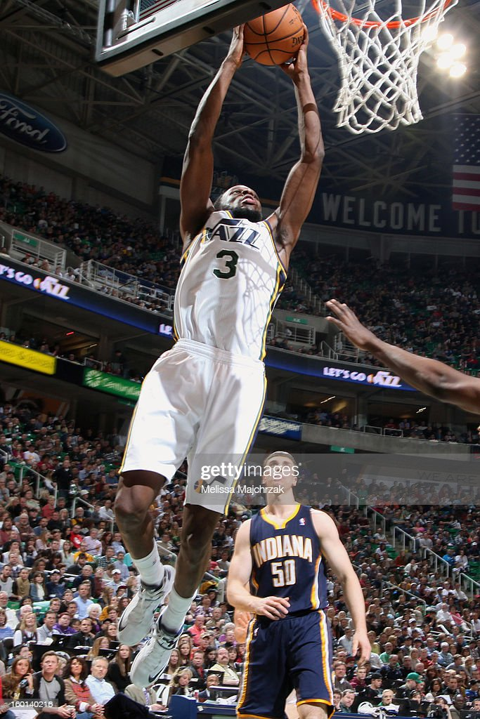<a gi-track='captionPersonalityLinkClicked' href=/galleries/search?phrase=DeMarre+Carroll&family=editorial&specificpeople=784686 ng-click='$event.stopPropagation()'>DeMarre Carroll</a> #3 of the Utah Jazz dunks against <a gi-track='captionPersonalityLinkClicked' href=/galleries/search?phrase=Tyler+Hansbrough&family=editorial&specificpeople=642794 ng-click='$event.stopPropagation()'>Tyler Hansbrough</a> #50 of the Indiana Pacers at Energy Solutions Arena on January 26, 2013 in Salt Lake City, Utah.
