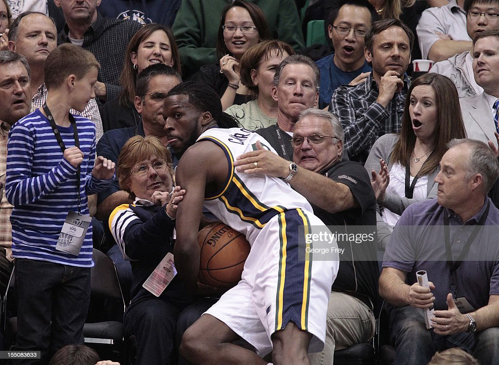 <a gi-track='captionPersonalityLinkClicked' href=/galleries/search?phrase=DeMarre+Carroll&family=editorial&specificpeople=784686 ng-click='$event.stopPropagation()'>DeMarre Carroll</a> #3 of the Utah Jazz falls into the crowd during a game against the Dallas Mavericks during the second half of an NBA game October 31, 2012 at EnergySolution Arena in Salt Lake City, Utah.