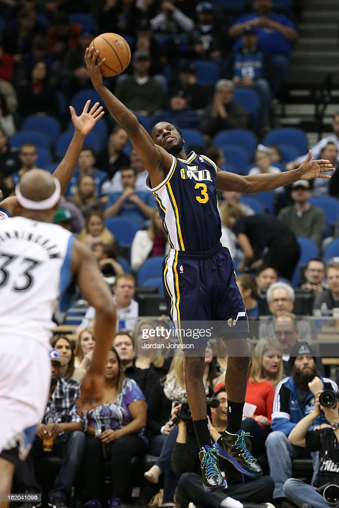 DeMarre Carroll #3 of the Utah Jazz grabs a rebound against the Minnesota Timberwolves on February 13, 2013 at Target Center in Minneapolis, Minnesota.