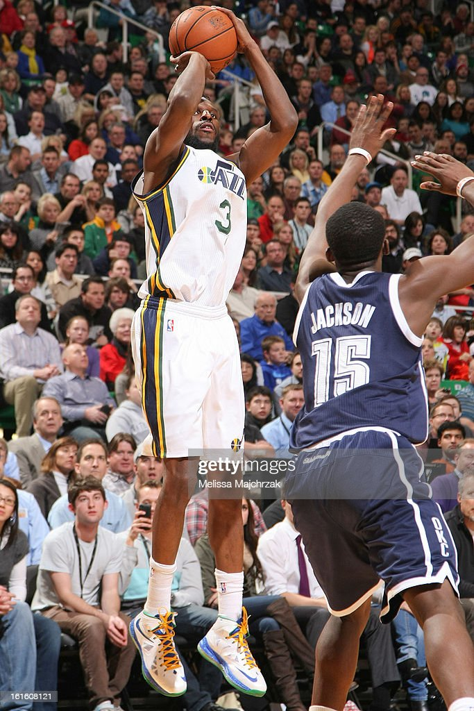DeMarre Carroll #3 of the Utah Jazz shoots against Reggie Jackson #15 of the Oklahoma City Thunder at Energy Solutions Arena on February 12, 2013 in Salt Lake City, Utah.