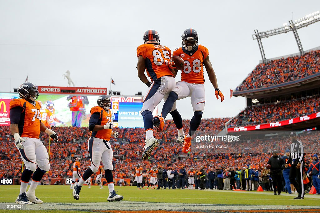 <a gi-track='captionPersonalityLinkClicked' href=/galleries/search?phrase=Demaryius+Thomas&family=editorial&specificpeople=4536795 ng-click='$event.stopPropagation()'>Demaryius Thomas</a> #88 celebrates a first quarter touchdown with <a gi-track='captionPersonalityLinkClicked' href=/galleries/search?phrase=Virgil+Green&family=editorial&specificpeople=7250502 ng-click='$event.stopPropagation()'>Virgil Green</a> #85 of the Denver Broncos against the Indianapolis Colts during a 2015 AFC Divisional Playoff game at Sports Authority Field at Mile High on January 11, 2015 in Denver, Colorado.