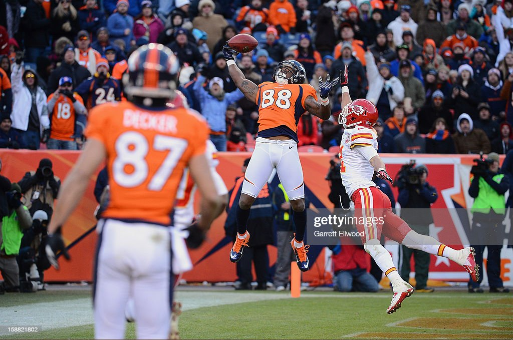 Demaryius Thomas #88 of the Denver Broncos catches a touchdown pass against Javier Arenas #21 of the Kansas City Chiefs at Sports Authority Field at Mile High on December 30, 2012 in Denver, Colorado.