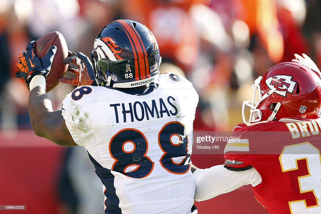 Demaryius Thomas #88 of the Denver Broncos catches a touchdown pass over Jalil Brown #30 of the Kansas City Chiefs at Arrowhead Stadium on November 25, 2012 in Kansas City, Missouri. The Broncos defeated the Chiefs 17-9.