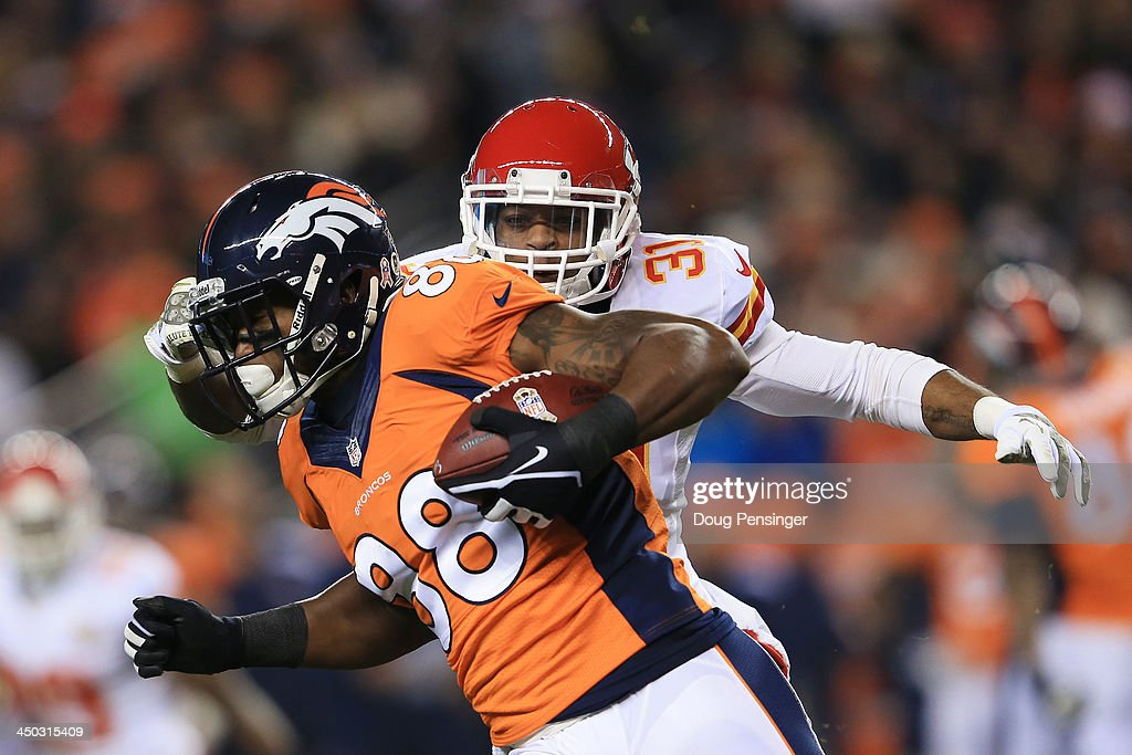 Demaryius Thomas #88 of the Denver Broncos completes a first down reception against the defense of Marcus Cooper #31 of the Kansas City Chiefs in the second quarter at Sports Authority Field at Mile High on November 17, 2013 in Denver, Colorado.