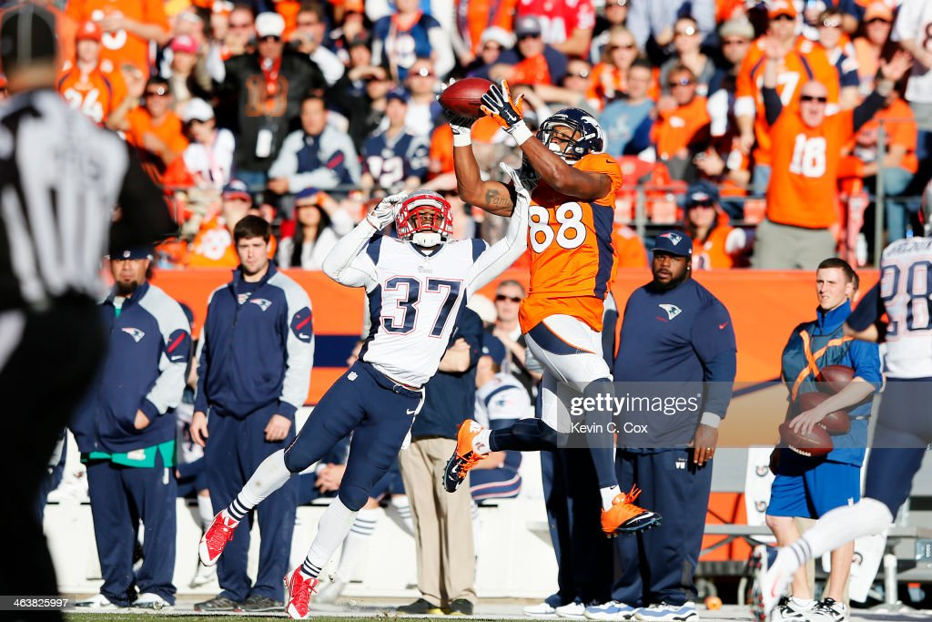 <a gi-track='captionPersonalityLinkClicked' href=/galleries/search?phrase=Demaryius+Thomas&family=editorial&specificpeople=4536795 ng-click='$event.stopPropagation()'>Demaryius Thomas</a> #88 of the Denver Broncos completes a fourth quarter reception against <a gi-track='captionPersonalityLinkClicked' href=/galleries/search?phrase=Alfonzo+Dennard&family=editorial&specificpeople=5651216 ng-click='$event.stopPropagation()'>Alfonzo Dennard</a> #37 of the New England Patriots during the AFC Championship game at Sports Authority Field at Mile High on January 19, 2014 in Denver, Colorado.