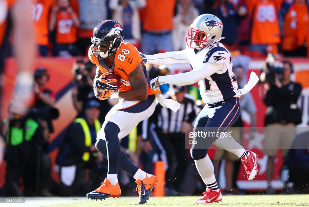 Demaryius Thomas #88 of the Denver Broncos completes a third quarter touchdown reception against the defense of Alfonzo Dennard #37 of the New England Patriots during the AFC Championship game at Sports Authority Field at Mile High on January 19, 2014 in Denver, Colorado.