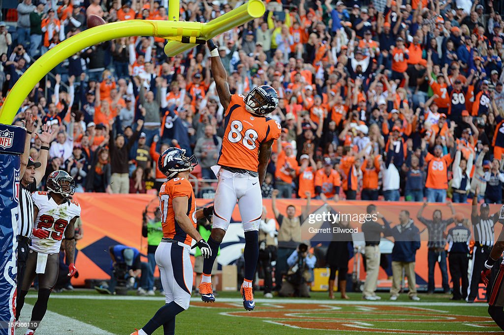 Demaryius Thomas #88 of the Denver Broncos dunks the football over the goal post following a touchdown against the Tampa Bay Buccaneers at Sports Authority Field at Mile High on December 2, 2012 in Denver, Colorado.